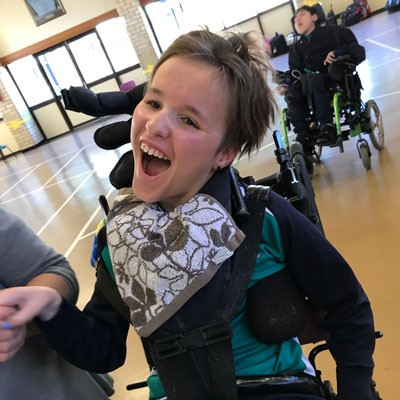 Girl in a wheelchair laughing