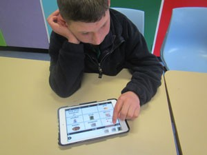 Student using iPad to communicate